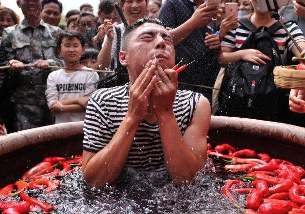 A spicy affair! Chinese man downs 47 chillies in two minutes, wins golden chilli as reward