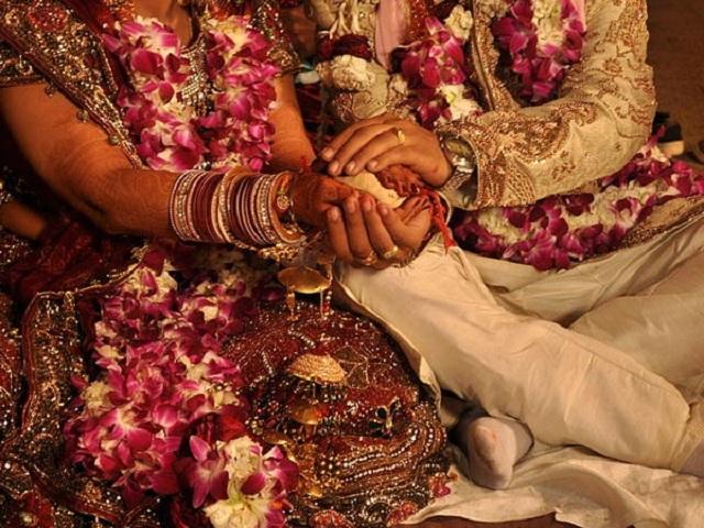 groom watches wedding online